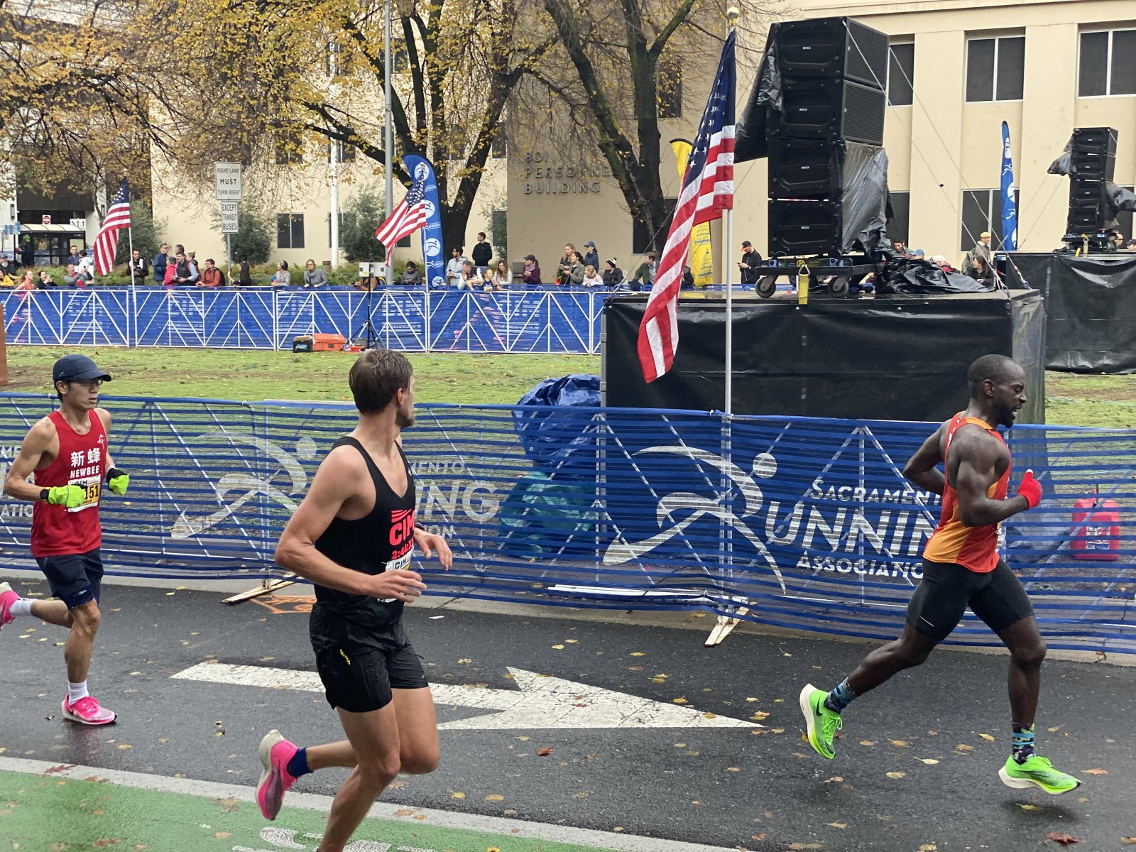 CIM pacer looking to the left at the women's finish line as he runs to the men's