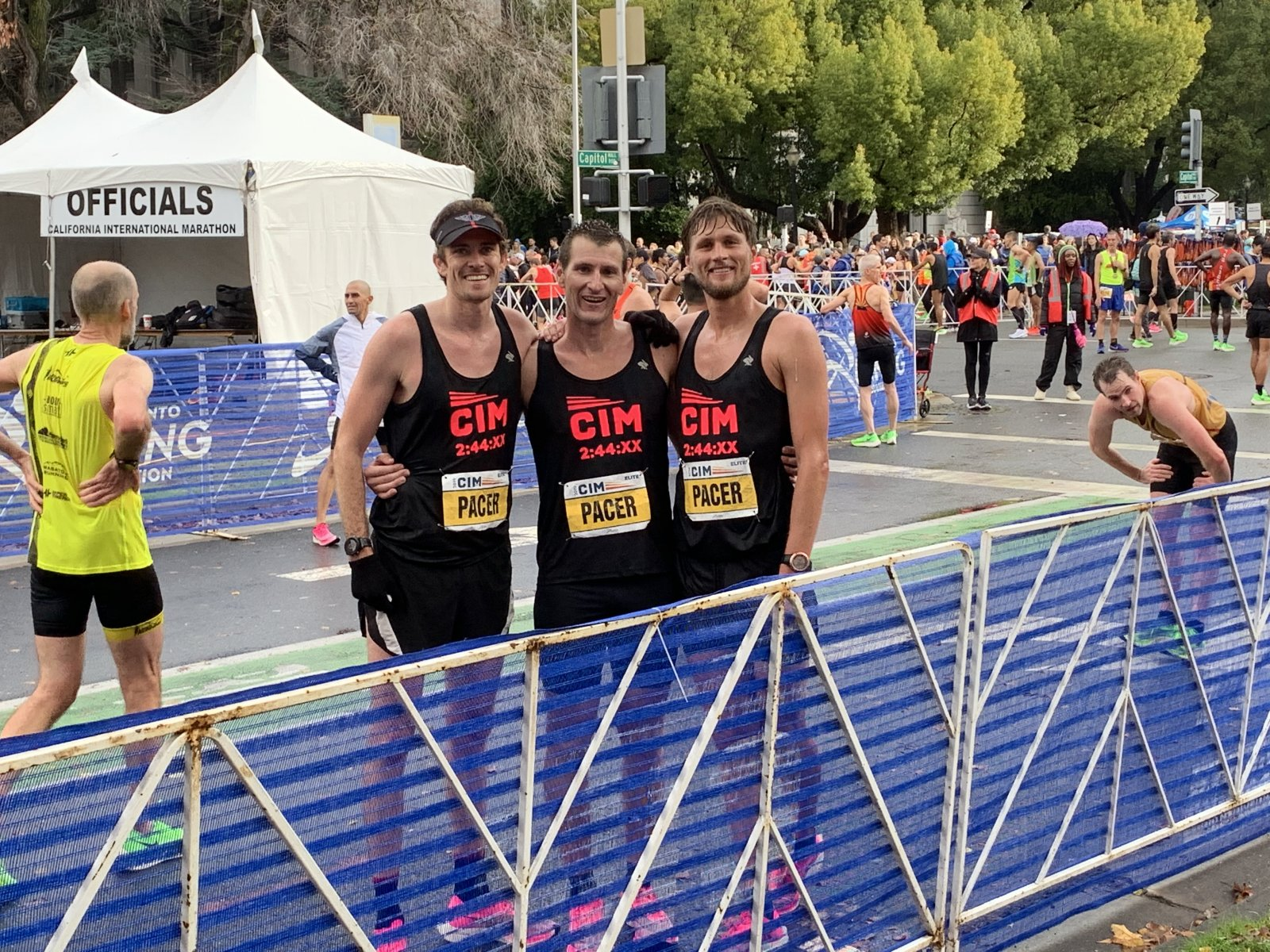 3 CIM pacers with arms around each other after the finish line